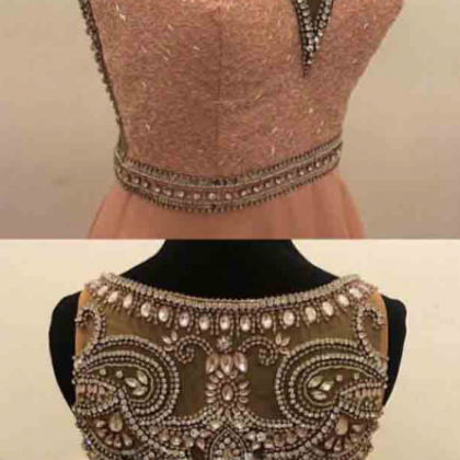 A ball gown with a pink beaded neck..