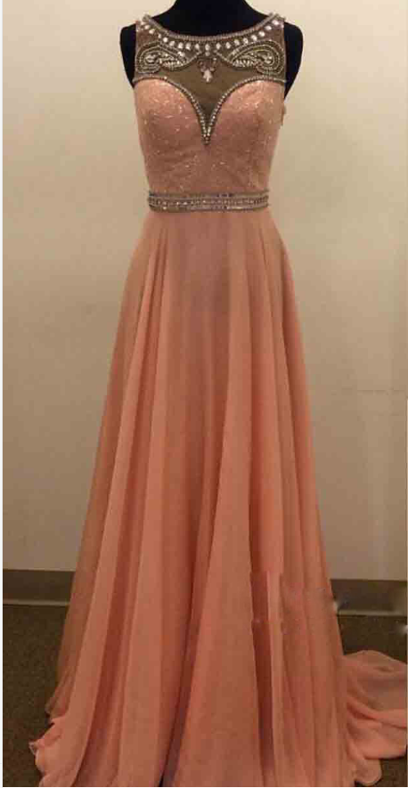 A ball gown with a pink beaded necklace. Evening dress