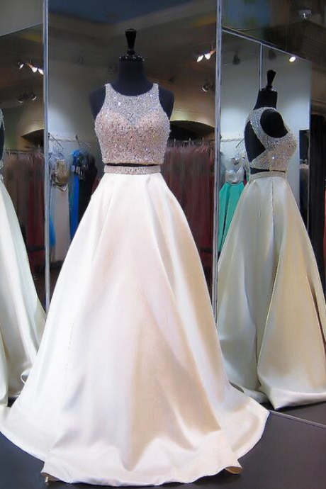 Two ball gowns with beaded head, evening dress.