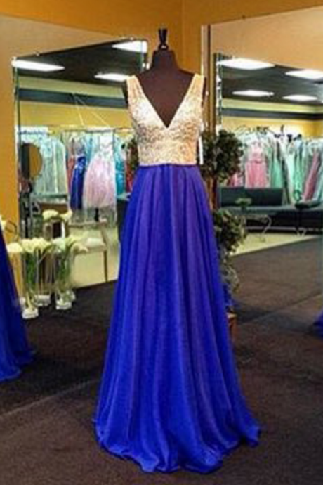 The royal blue beads are decorated with crystal ball gowns and v-neck gowns.
